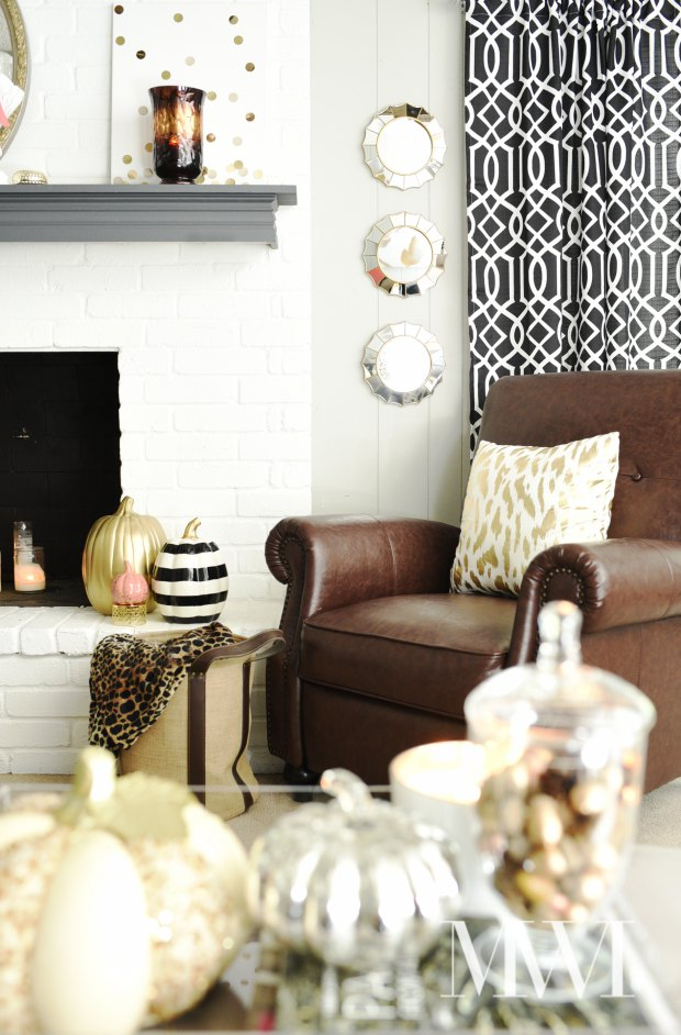 A chic and feminine twist on fall decor. Lots of gold glam touches mixed with coral and other black and white patterns.