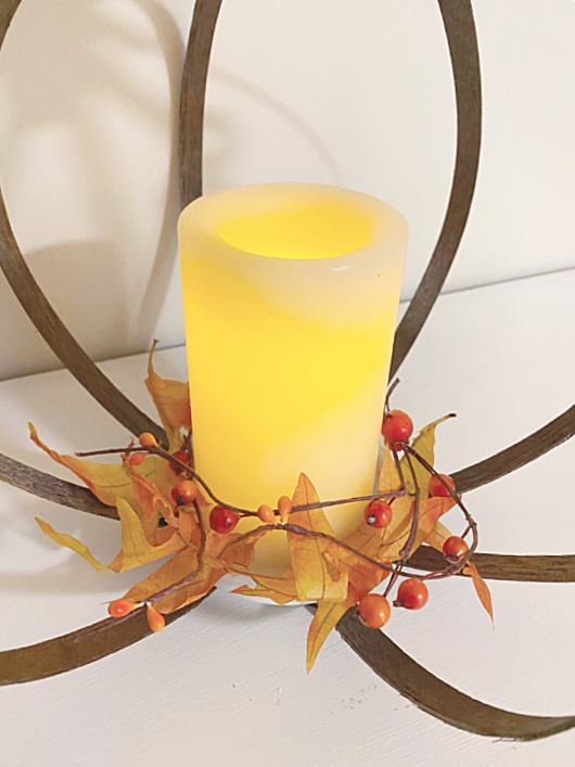 flameless candle with fall foliage