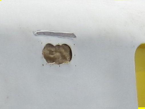 mended fiberglass hole ready for Bondo
