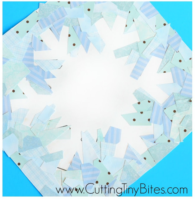 Winter snowflake paper collage craft for kids to show negative space