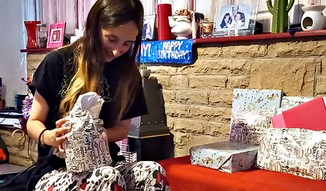My eldest opening her birthday presents