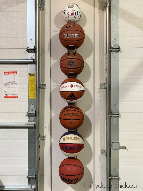 Skinny and tall wall basketball holder