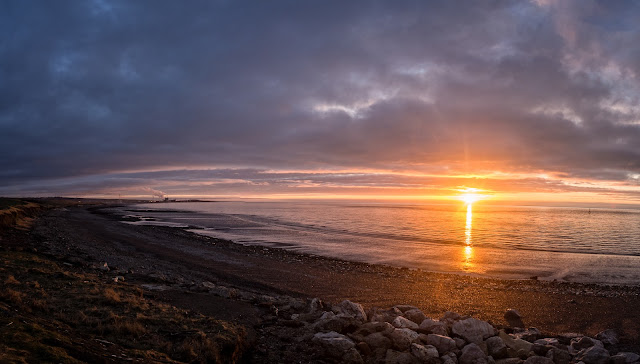 Photo of the sun going down over Maryport beach