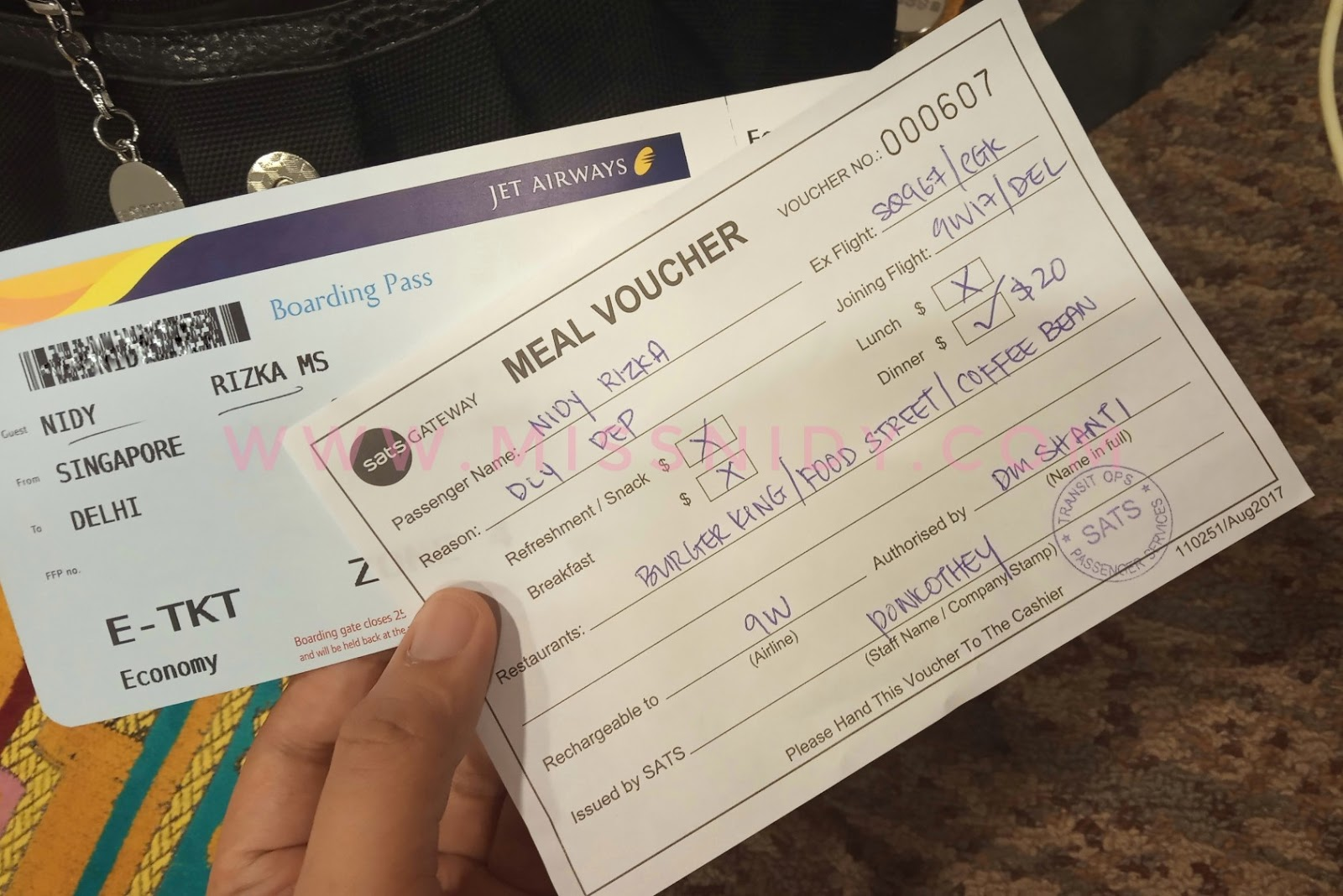 voucher kompensasi pesawat jet airways delay di singapura