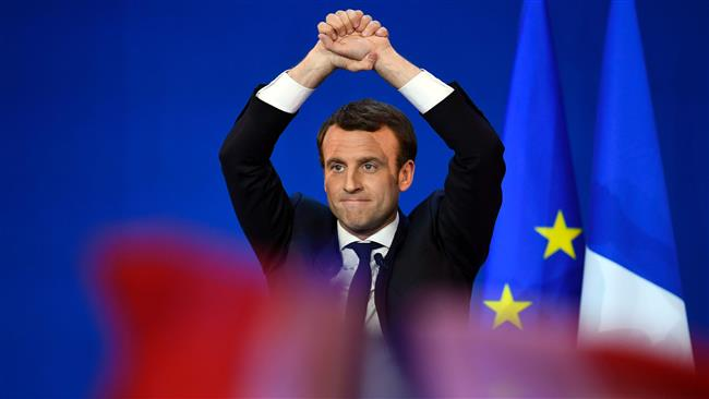 Emmanuel Macron pledges to turn new page in French politics