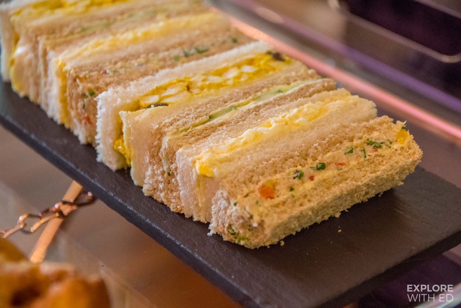 Finger sandwiches including coronation chicken, part of The Mulberry Bar Afternoon Tea