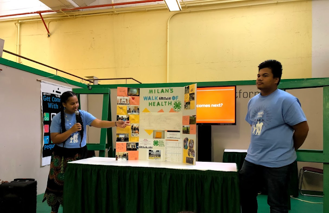Brother and sister team J.Y. and Josephine from Milan presented at the MN State Fair for the very first time. Standing in front on their display.