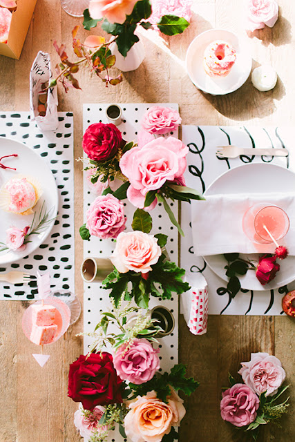 a romantic table with black and white glam touches - pegboard centerpiece of flowers and handmade placesets