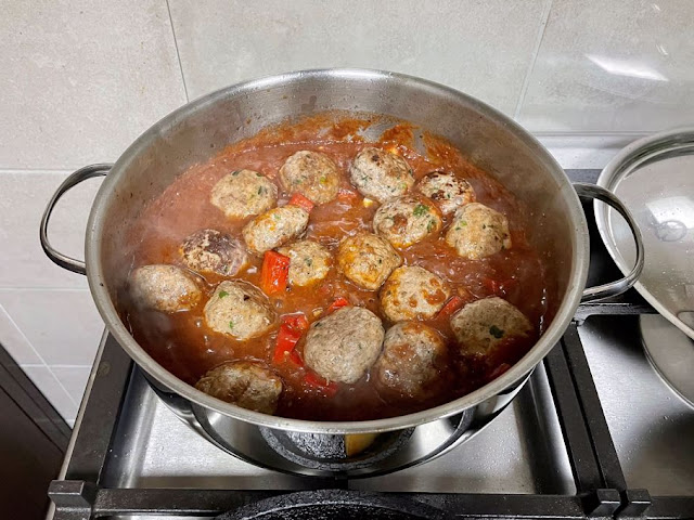 meatballs added to tomato sauce