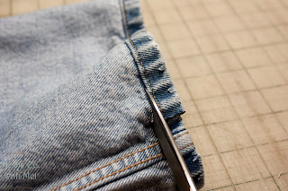 cutting off jean hem