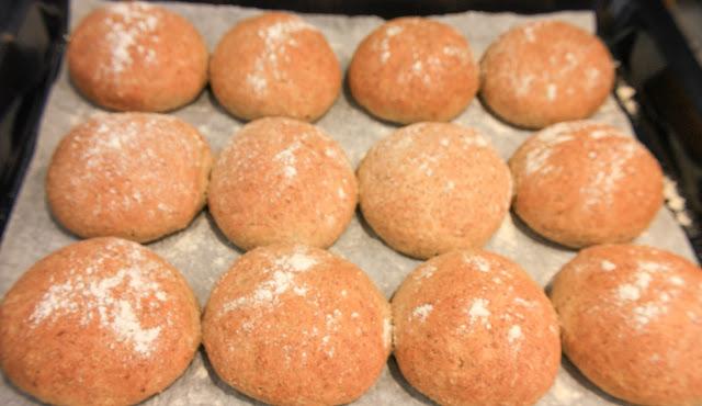 Tray of twleve freshly baked rolls.