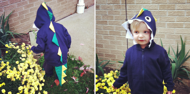 Little boy wearing a DIY dinosaur costume