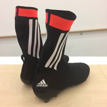 a30b19c9d093 The black Adidas Primeknit Full Sock 2015 Football Boot features a knitted  one-piece upper with a sock-silhouette design
