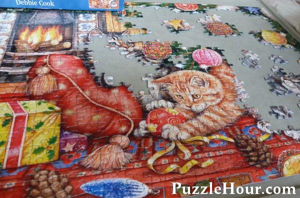 500 piece Christmas cat jigsaw puzzle design working on a jigboard