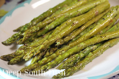 Fresh asparagus, oven-roasted with an olive oil and lemon vinaigrette. Top with cheese and buttered bread crumbs for a gratin.