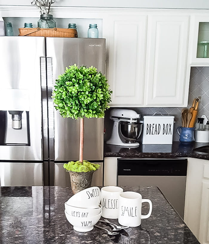 boxwood topiary with Rae Dunn pieces