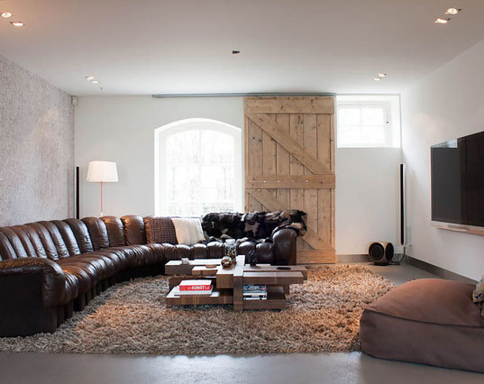 image result for masculine contemporary room with leather sectional and barn door window cover