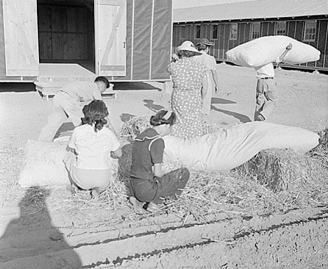 Internees in Arizona making mattresses with straw on 21 May 1942 worldwartwo.filminspector.com