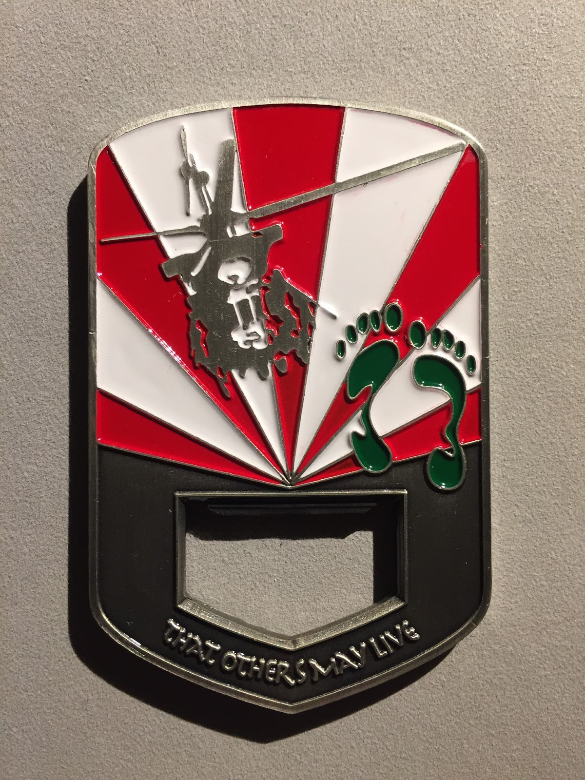 THE USAF RESCUE COLLECTION: USAF 33rd RQS Challenge Coin - Bottle Opener