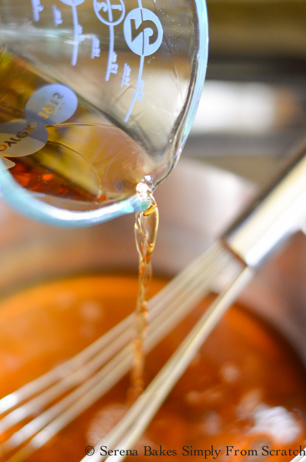 Whisk together sugar and water, cook until dissolved. Add vanilla and whisky.