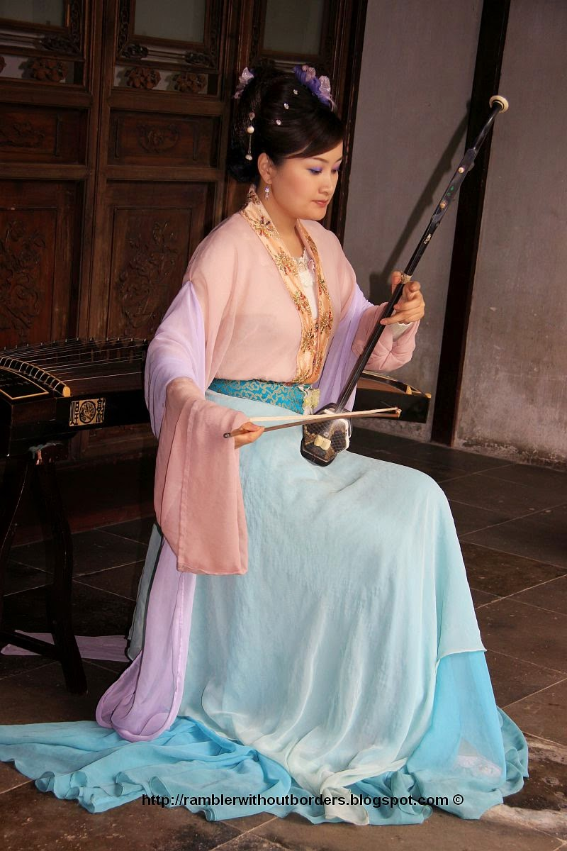Erhu player in classical costume in a Suzhou Chinese classical Garden
