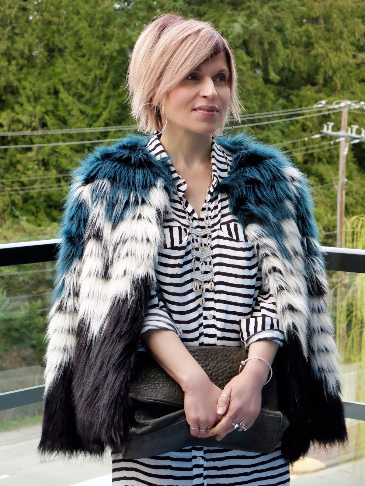 striped shirtdress and colour-blocked, faux-fur jacket