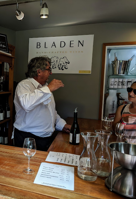 Blenheim wineries: John Lowes at the cellar door of Bladen Wines in Marlborough New Zealand