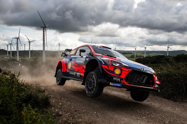 Rally racing car jumping