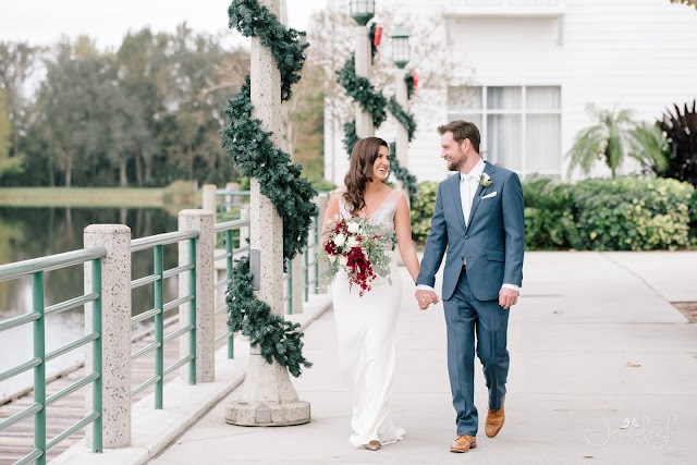 bride and groom walking with christmas decor