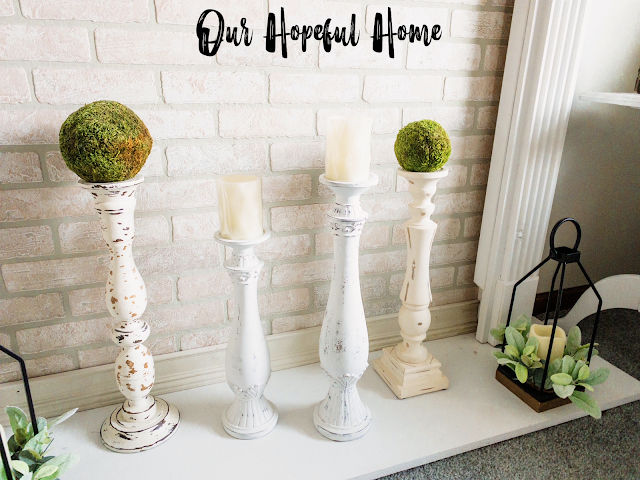 four tall white painted distressed floor candle holders