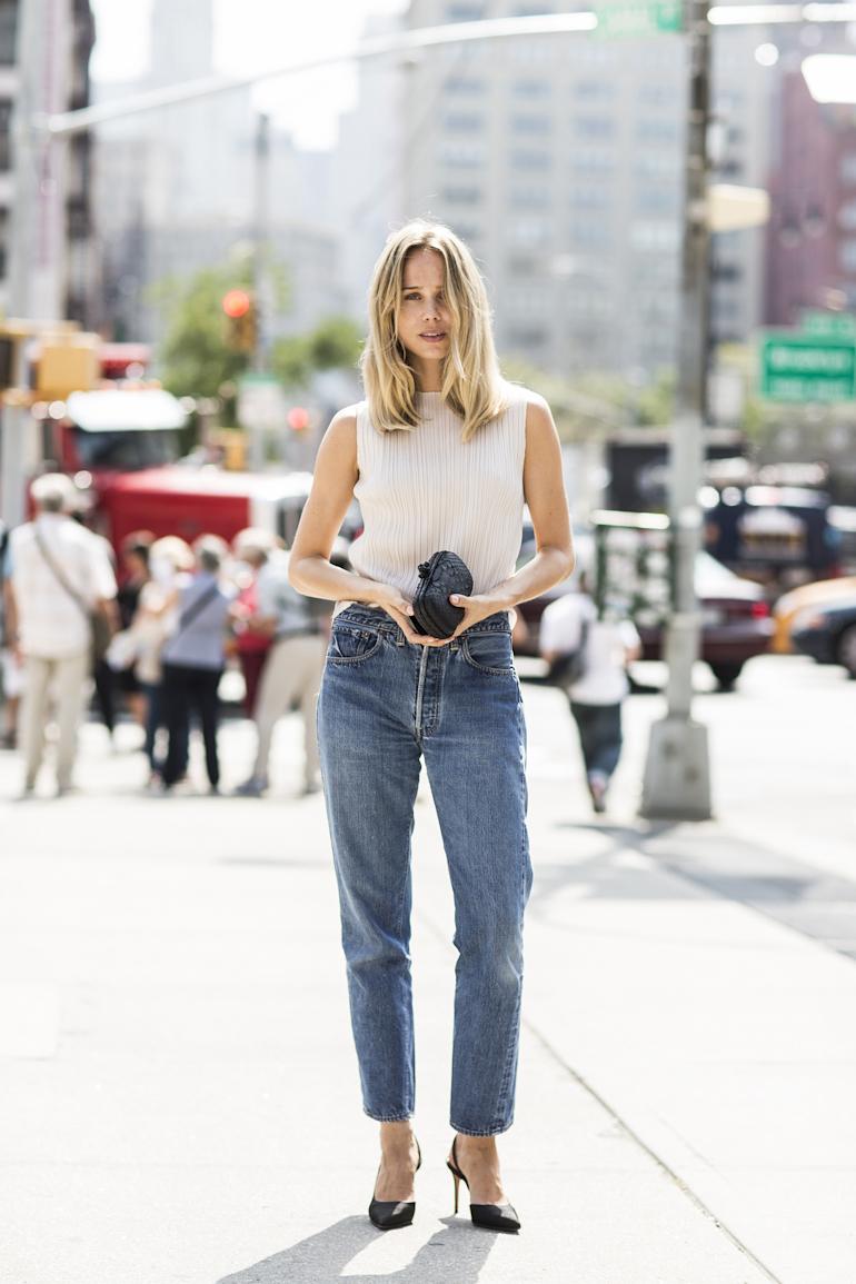 Chic Denim Outfit Idea — Elin Kling Street Style Shot by Sandra Semburg — Pleated Sleeveless Top, Straight-Leg Jeans, and Slingback Pumps