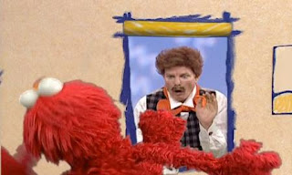 Elmo tries to wave hello to Mr. Noodle with his feet. Elmo loses his balance and falls backward. Sesame Street Elmo's World Feet.