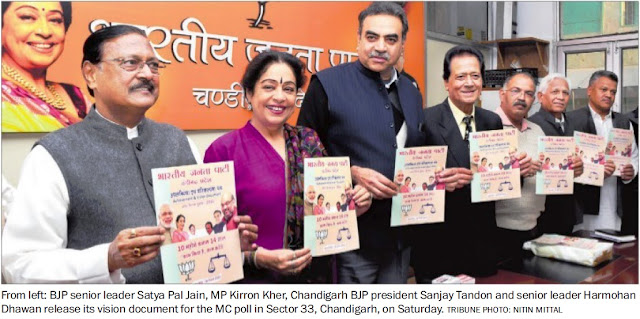 BJP senior leader Satya Pal Jain, MP Kirron Kher, Chandigarh BJP president Sanjay Tandon and Harmohan Dhawan release its vision document for the MC poll in Sector 33, Chandigarh