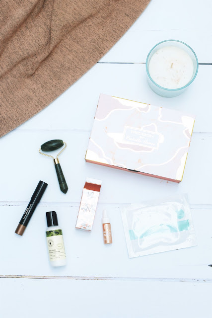 January Birchbox featuring a variety of makeup and skincare