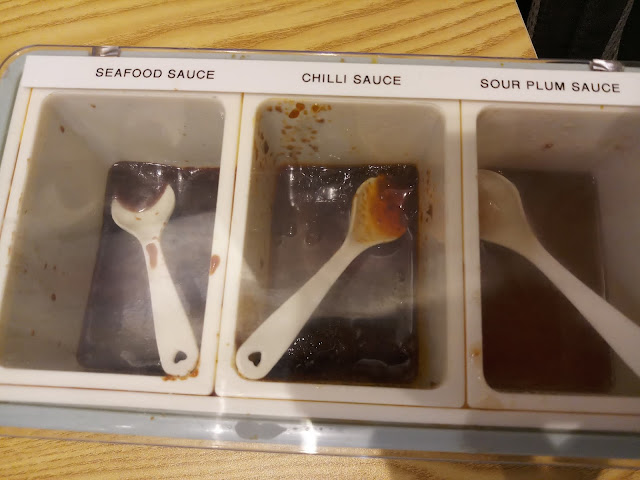 Sauces on display (From left to right): Seafood sauce, Chili sauce, Sour plum sauce