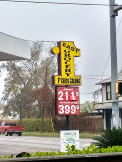 A gas station sign saying, 'Unleaded: 2.19, Kombucha on Tap: 3.99'.