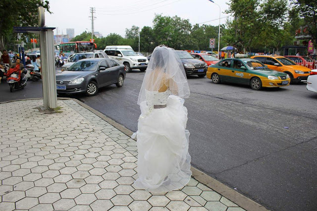 True love waits! They are past their wedding schedule but this bride still waited for her groom along the road!
