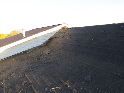 clearing bad shingles of a roof