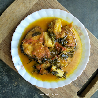 Assamese style fish curry with pirali paleng, taro root and tomatoes