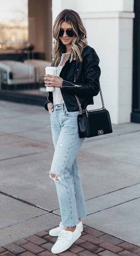 how to wear a leather jacket : blouse + crossbody bag + boyfriend jeans + sneakers