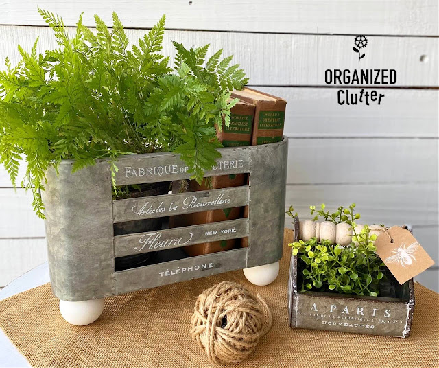 Photo of upcycled galvanized containers with greenery