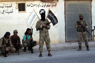 Combatientes rebeldes en Dabiq, en el norte de Alepo (Siria)Khalil AshawiReuters