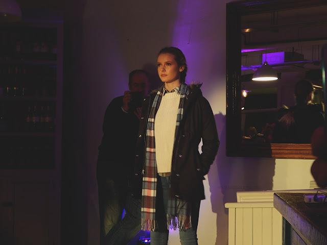 Model posing at the end of a runway