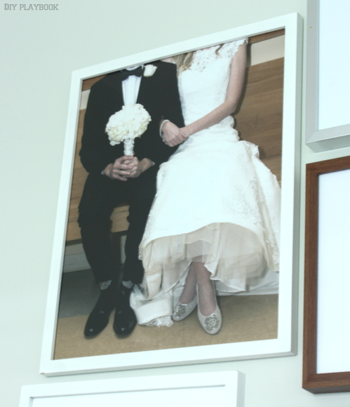 Wedding photo print on an office gallery wall.