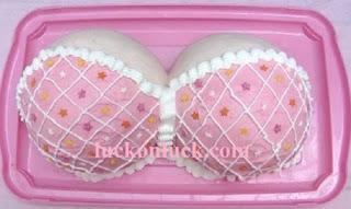 Covered pink color breasts partly covered with bra