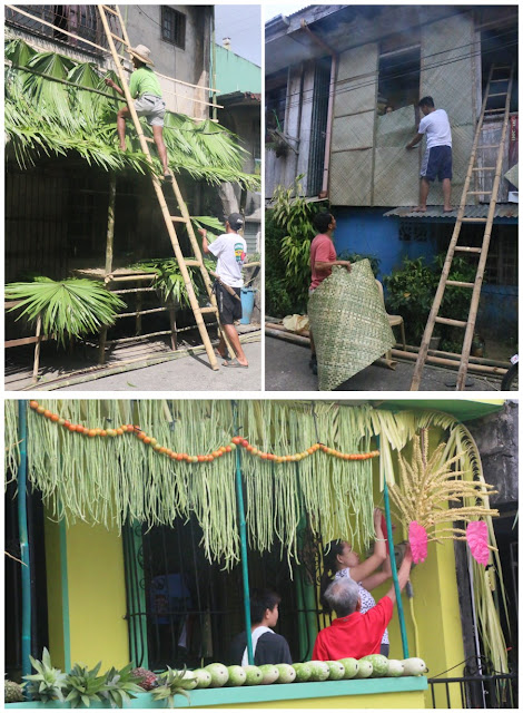 Residents decorate their houses in preparation for the Pahiyas Festival in Lucban, Quezon.