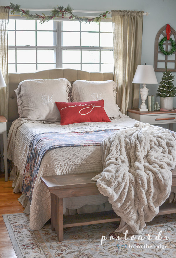 bedroom with ruched faux fur throw blanket, red pillow, french quilt, linen shams