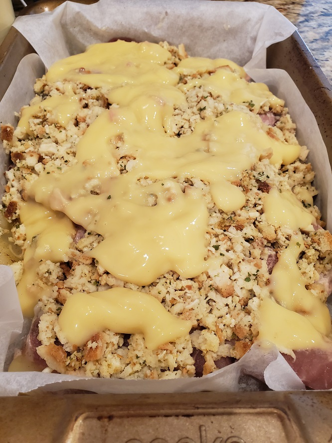 this is a casserole with cream of chicken soup, pork chops and stuffing with apples