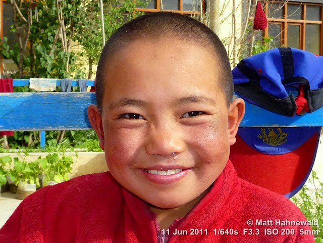 people, street portrait, young Tibetan Buddhist nun, Tibetan Buddhism, Mahayana Buddhist nunnery, Leh, Ladakh, Northern India, headshot, girl nun, Facing the World, © Matt Hahnewald