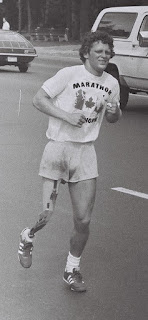 Young man with prostetic leg runs along the highway - Terry Fox